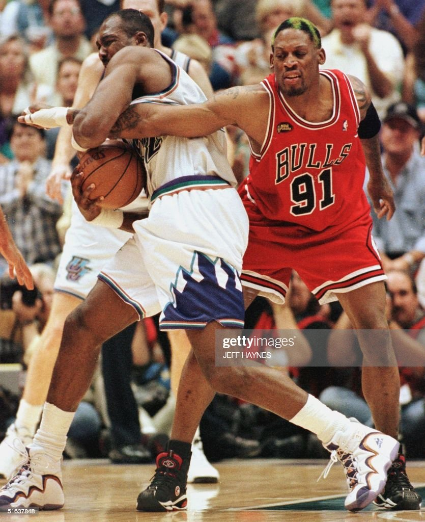Dennis Rodman R of the Chicago Bulls s his ar