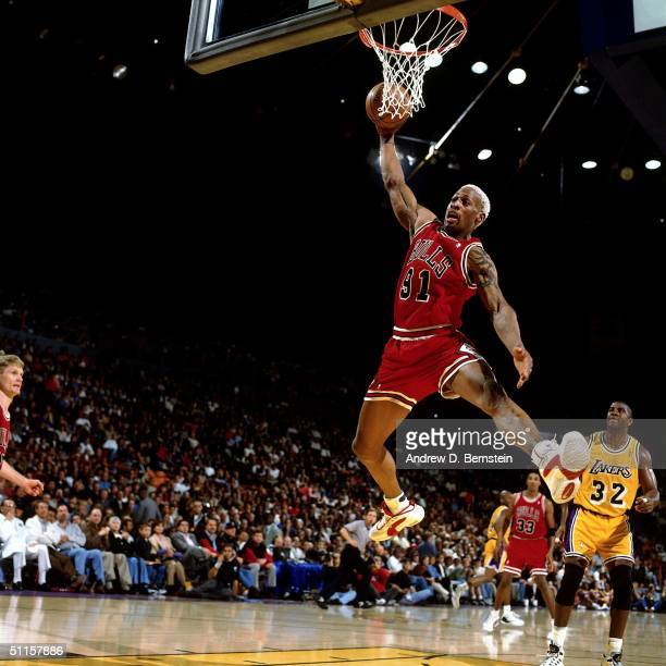 Dennis Rodman of the Chicago Bulls goes for a rebound during a game against the Los Angeles lakers at the Great Western Forum on February 2 1996 in...