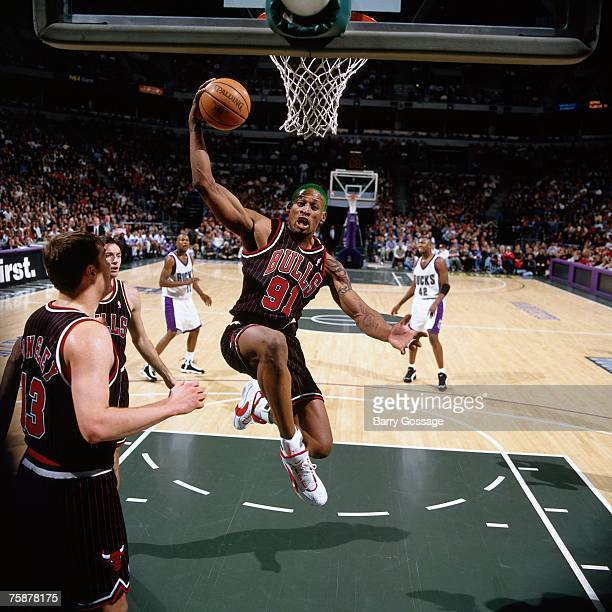 Dennis Rodman of the Chicago Bulls grabs a rebound against the Milwaukee Bucks during a 1996 NBA game at the Bradley Center in Milwaukee Wisconsin...
