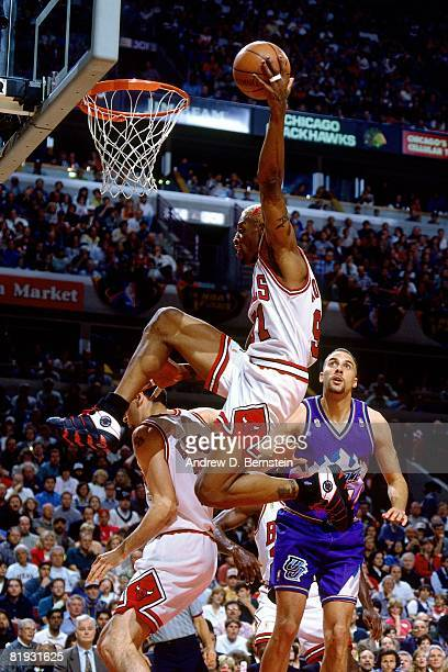 Dennis Rodman of the Chicago Bulls grabs a rebound in Game One of the 1997 NBA Finals against the Utah Jazz at the United Center on June 1 1997 in...