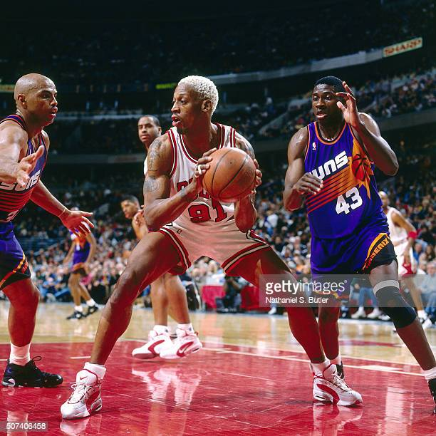 Dennis Rodman of the Chicago Bulls passes the ball against the Phoenix Suns on January 28 1996 at the United Center in Chicago Ilinois NOTE TO USER...