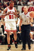 Dennis Rodman of the Chicago Bulls pleads with offical Joe Crawford after being called for a foul 17 May during the first half of game one of his NBA...
