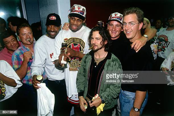 Dennis Rodman of the Chicago Bulls poses for a photo with Pearl Jam lead singer Eddie Vedder after defeating the Seattle SuperSonics in Game Six of...