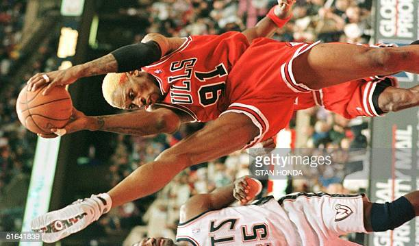 Dennis Rodman of the Chicago Bulls pulls down a rebound in the third quarter of game against the New Jersey Nets 20 December at the Continental Arena...