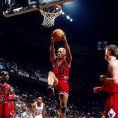 Dennis Rodman of the Chicago Bulls rebounds against the Miami Heat in Game Three of the Eastern Conference Finals during the 1997 NBA Playoffs at...