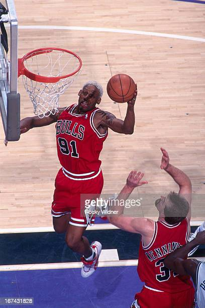 Dennis Rodman of the Chicago Bulls rebounds against the Sacramento Kings on February 1 1996 at Arco Arena in Sacramento California NOTE TO USER User...