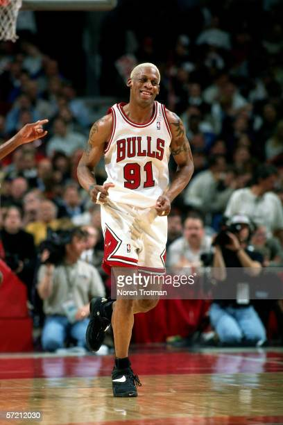 Dennis Rodman of the Chicago Bulls runs on the court during game two round two of the NBA Playoffs against the New York Knicks at Chicago Stadium on...