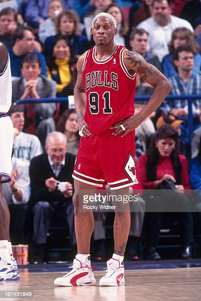 Dennis Rodman of the Chicago Bulls stands against the Sacramento Kings on February 1 1996 at Arco Arena in Sacramento California NOTE TO USER User...