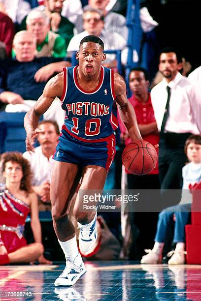 Dennis Rodman of the Detroit Pistons advances the ball against the Sacramento Kings during a game played on February 23 1988 at Arco Arena in...