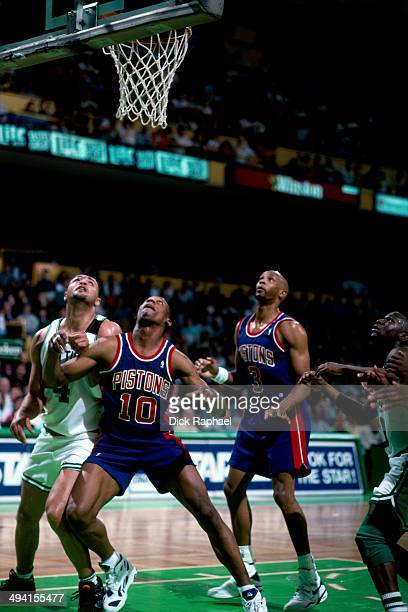 Dennis Rodman of the Detroit Pistons and Alaa Abdelnaby of the Boston Celtics battle for position during a game played at the Boston Garden in Boston...