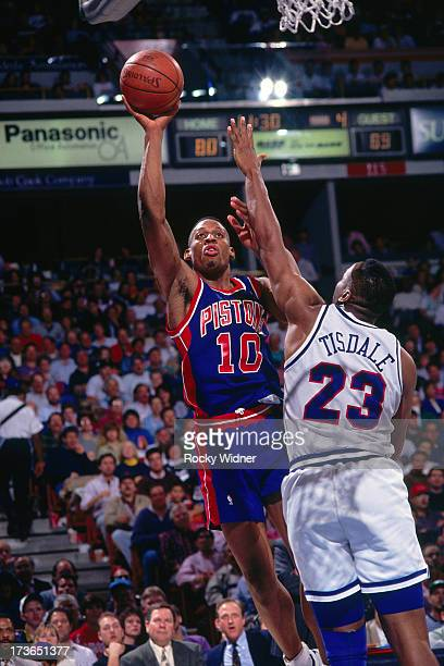 Dennis Rodman of the Detroit Pistons attempts a shot against Wayman Tisdale of the Sacramento Kings during a game played on March 16 1993 at Arco...