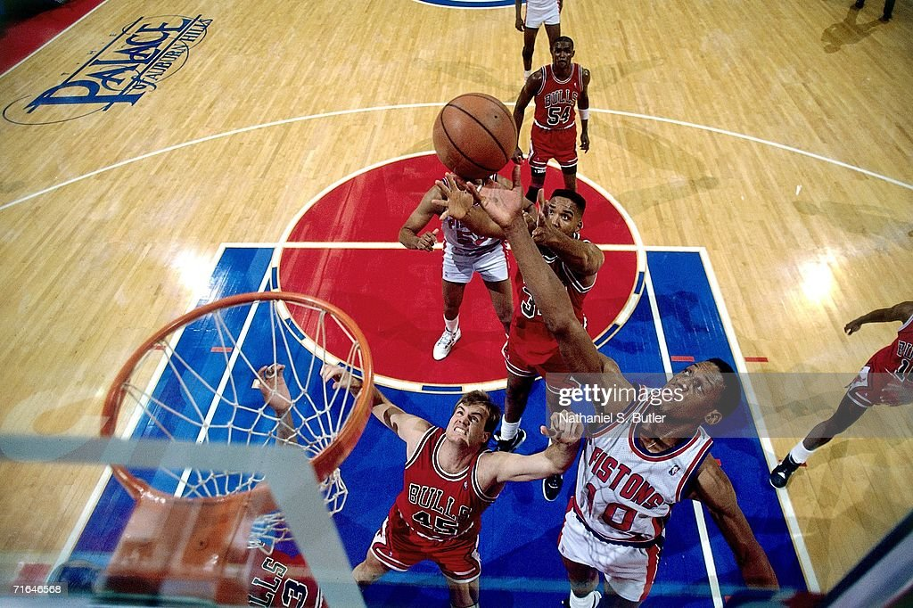 Dennis Rodman of the Detroit Pistons battles for a rebound against Scottie Pippen of the Chicago Bulls during a 1990 playoff game played at the...