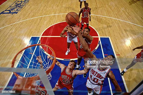 Dennis Rodman of the Detroit Pistons grabs a rebound against the Chicago Bulls during a game circa 1991 at The Palace of Auburn Hills in Detroit...