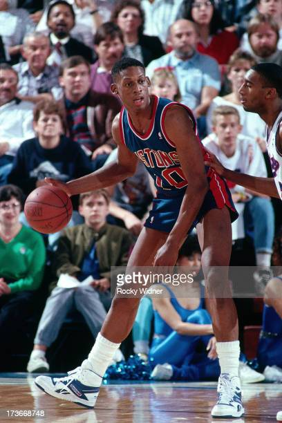 Dennis Rodman of the Detroit Pistons handles the ball against the Sacramento Kings during a game played on February 23 1988 at Arco Arena in...
