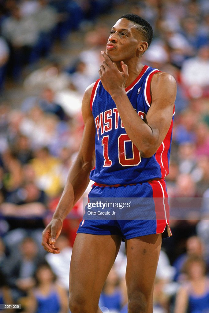 Dennis Rodman of the Detroit Pistons looks on during a game in the 19881989 NBA season