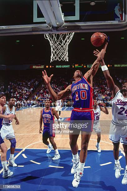 Dennis Rodman of the Detroit Pistons rebounds against the Sacramento Kings during a game played on March 14 1992 at Arco Arena in Sacramento...