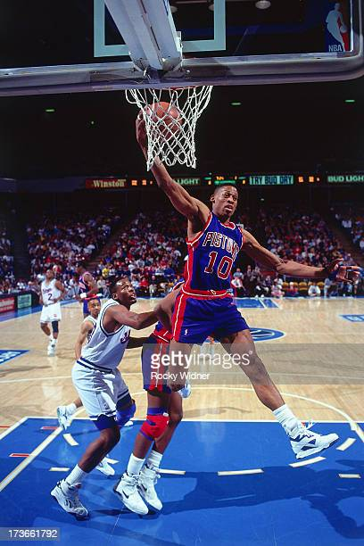 Dennis Rodman of the Detroit Pistons rebounds against the Sacramento Kings during a game played on December 8 1990 at Arco Arena in Sacramento...