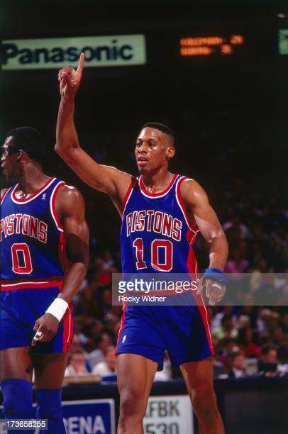 Dennis Rodman of the Detroit Pistons signals to his teammates during a game played against the Sacramento Kings on March 14 1992 at Arco Arena in...