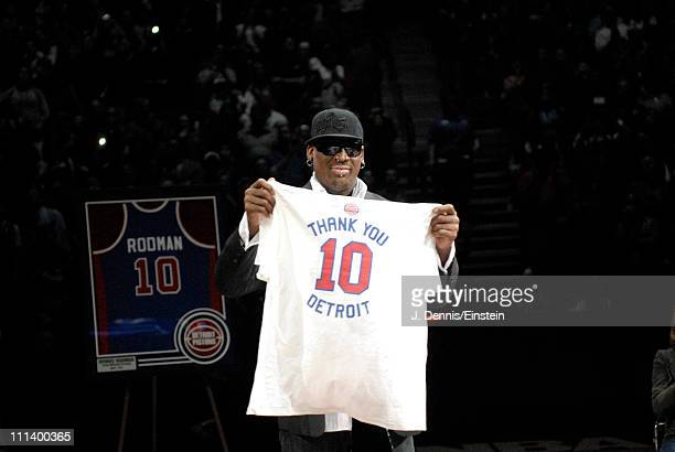 Dennis Rodman presents a tshirt he created during the retirement ceremony of his Detroit Pistons on April 1 2011 at The Palace of Auburn Hills in...