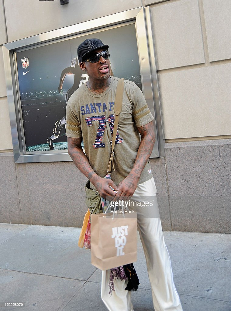 <a gi-track='captionPersonalityLinkClicked' href=/galleries/search?phrase=Dennis+Rodman&family=editorial&specificpeople=202643 ng-click='$event.stopPropagation()'>Dennis Rodman</a> seen outside the Niketown store on the streets of Manhattan on September 17, 2012 in New York City.