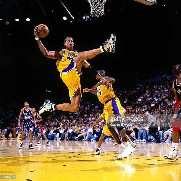 Dennis Rodman the Los Angeles Lakers grabs a rebound against the Houston Rockets during an NBA game at the Staples Center in Los Angeles California...
