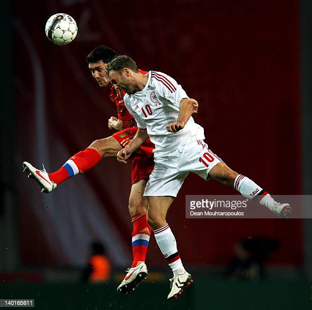 Dennis Rommedahl of Denmark and Yuriy Zhirkov of Russia battle for the ball during the International Friendly between Denmark and Russia at Parken...