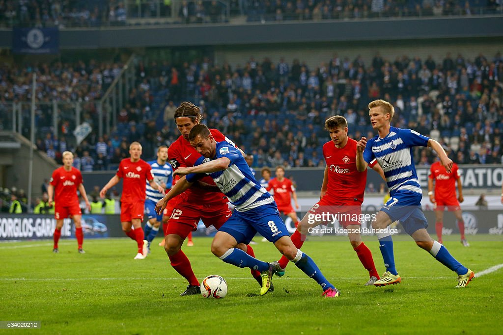 Dennis Russ of Wuerzburg (L) challenges Thomas Broeker of Duisburg during the Second Bundesliga play-off second leg match between MSV Duisburg and Wuerzburger Kickers at Schauinsland-Reisen-Arena on May 24, 2016 in Duisburg, Germany.