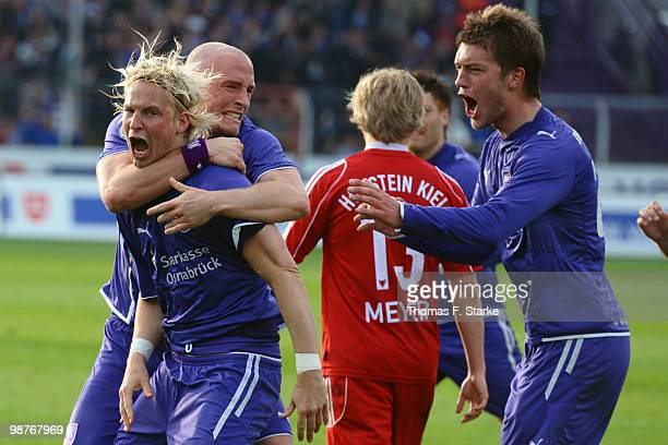 Dennis Schmidt Tobias Nickenig and Niels Hansen of Osnabrueck celebrate during the Third League match between VfL Osnabrueck and Holstein Kiel at the...