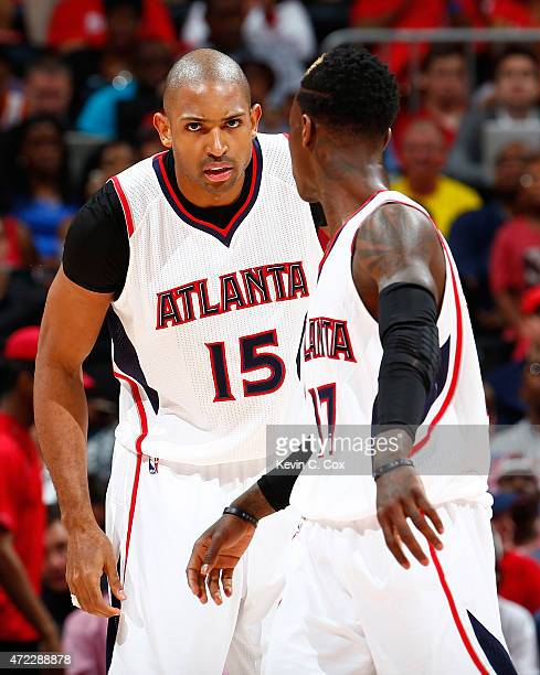 Dennis Schroder converses with Al Horford of the Atlanta Hawks after a basket against the Washington Wizards during Game Two of the Eastern...