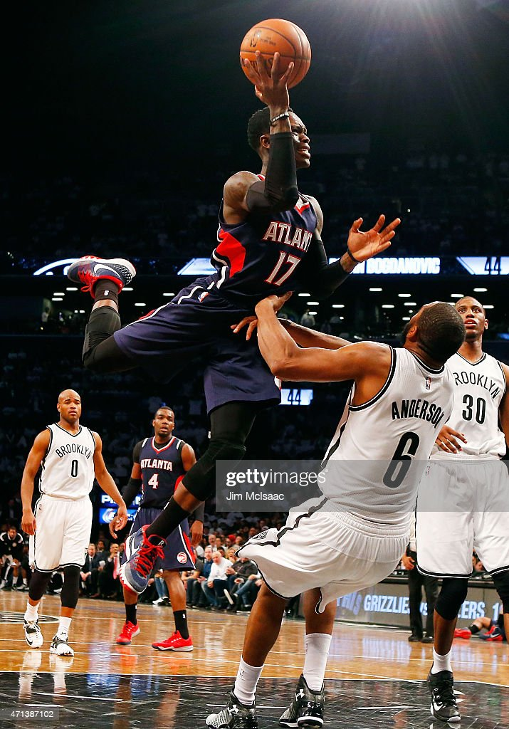 Dennis Schroder #17 of the Atlanta Hawks commits an offensive foul in the second half against <a gi-track='captionPersonalityLinkClicked' href=/galleries/search?phrase=Alan+Anderson&family=editorial&specificpeople=3945355 ng-click='$event.stopPropagation()'>Alan Anderson</a> #6 of the Brooklyn Nets during game four in the first round of the 2015 NBA Playoffs at Barclays Center on April 27, 2015 in the Brooklyn borough of New York City.