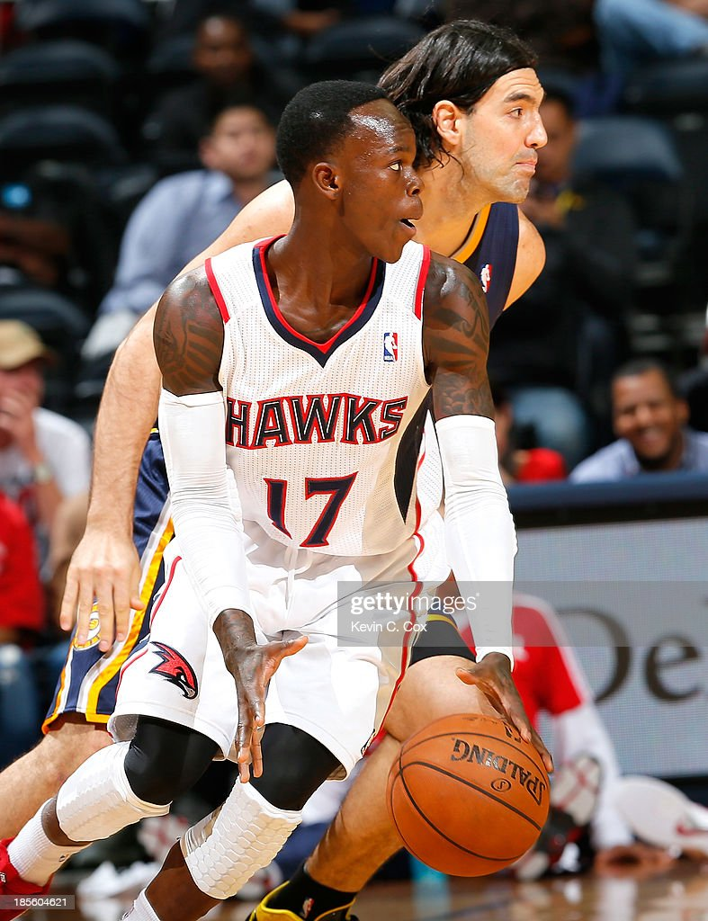 Dennis Schroder #17 of the Atlanta Hawks dribbles against <a gi-track='captionPersonalityLinkClicked' href=/galleries/search?phrase=Luis+Scola&family=editorial&specificpeople=2464749 ng-click='$event.stopPropagation()'>Luis Scola</a> #4 of the Indiana Pacers at Philips Arena on October 22, 2013 in Atlanta, Georgia.
