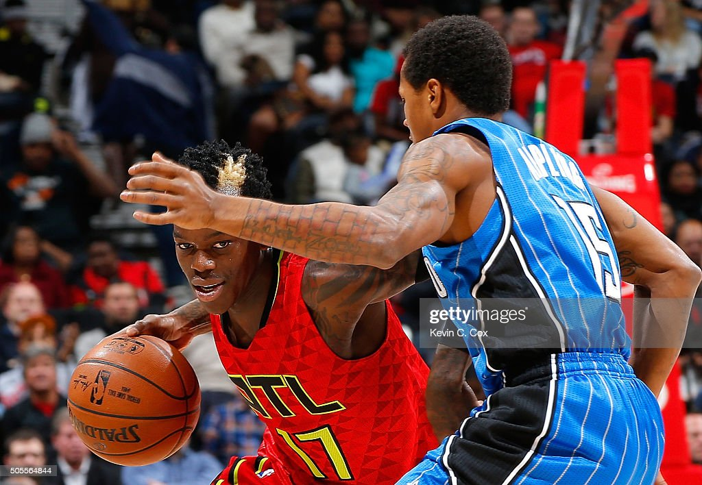 Dennis Schroder of the Atlanta Hawks drives against Keith Appling of the Orlando Magic at Philips Arena on January 18 2016 in Atlanta Georgia NOTE TO...