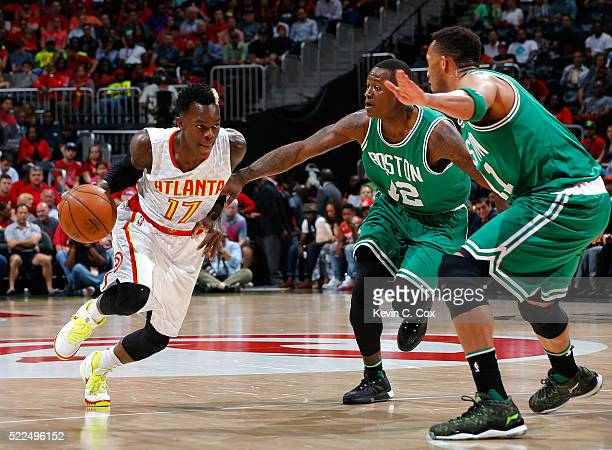 Dennis Schroder of the Atlanta Hawks drives against Terry Rozier and Evan Turner of the Boston Celtics in Game Two of the Eastern Conference...