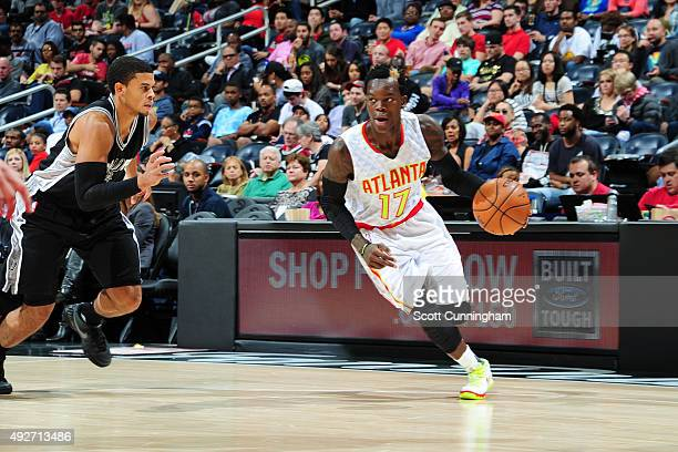Dennis Schroder of the Atlanta Hawks drives to the basket against the San Antonio Spurs on October 14 2015 at Philips Arena in Atlanta Georgia NOTE...