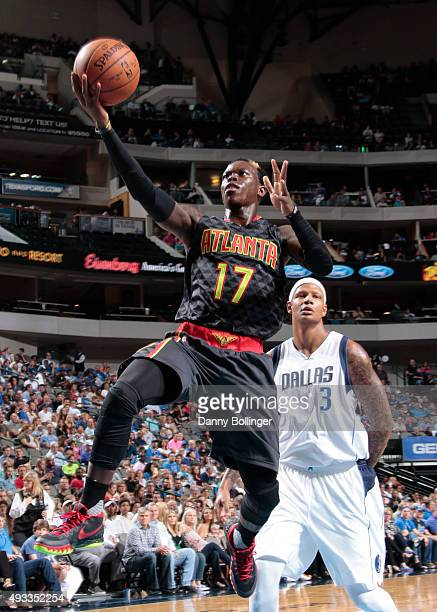Dennis Schroder of the Atlanta Hawks drives to the basket against the Dallas Mavericks during a preseason game on October 16 2015 at the American...