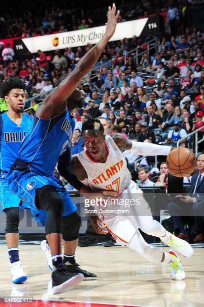 Dennis Schroder of the Atlanta Hawks drives to the basket against the Dallas Mavericks on March 1 2017 at Philips Arena in Atlanta Georgia NOTE TO...