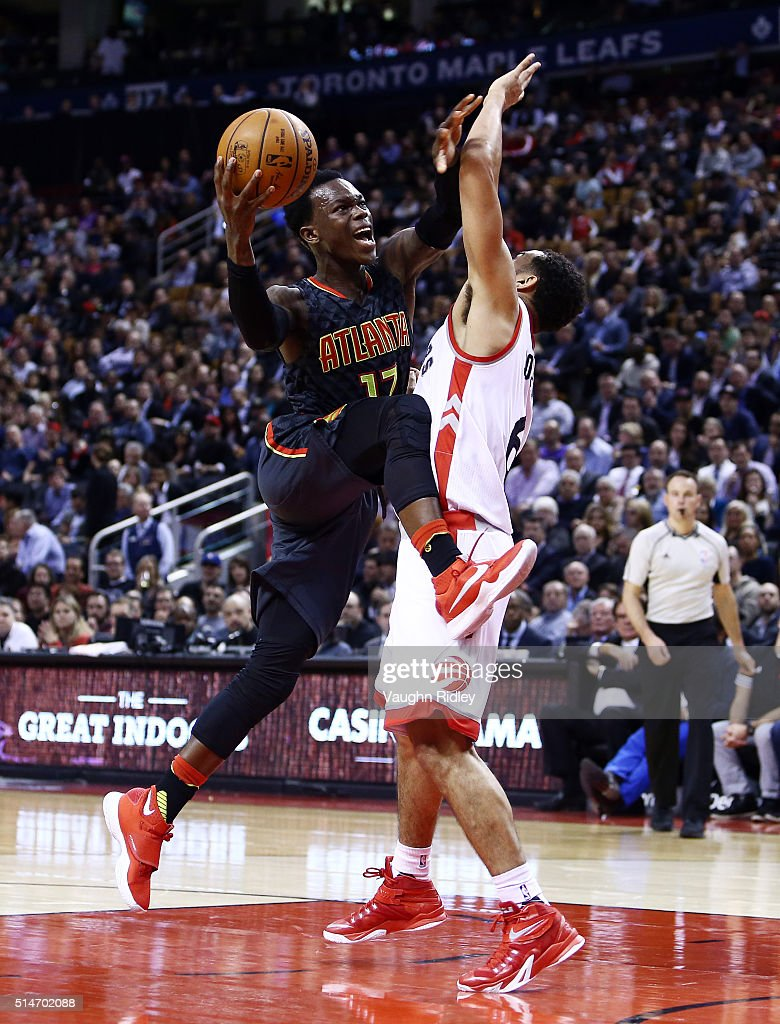 Dennis Schroder #17 of the Atlanta Hawks drives to the basket as <a gi-track='captionPersonalityLinkClicked' href=/galleries/search?phrase=Cory+Joseph&family=editorial&specificpeople=5953537 ng-click='$event.stopPropagation()'>Cory Joseph</a> #6 of the Toronto Raptors defends during the second half of an NBA game at the Air Canada Centre on March 10, 2016 in Toronto, Ontario, Canada.