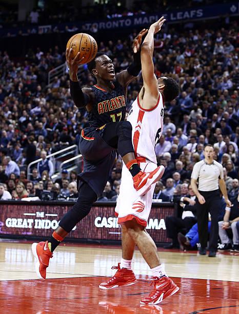 ... Dennis Schroder 17 of the Atlanta Hawks drives to the basket as Cory  Joseph ... 53e7c9551