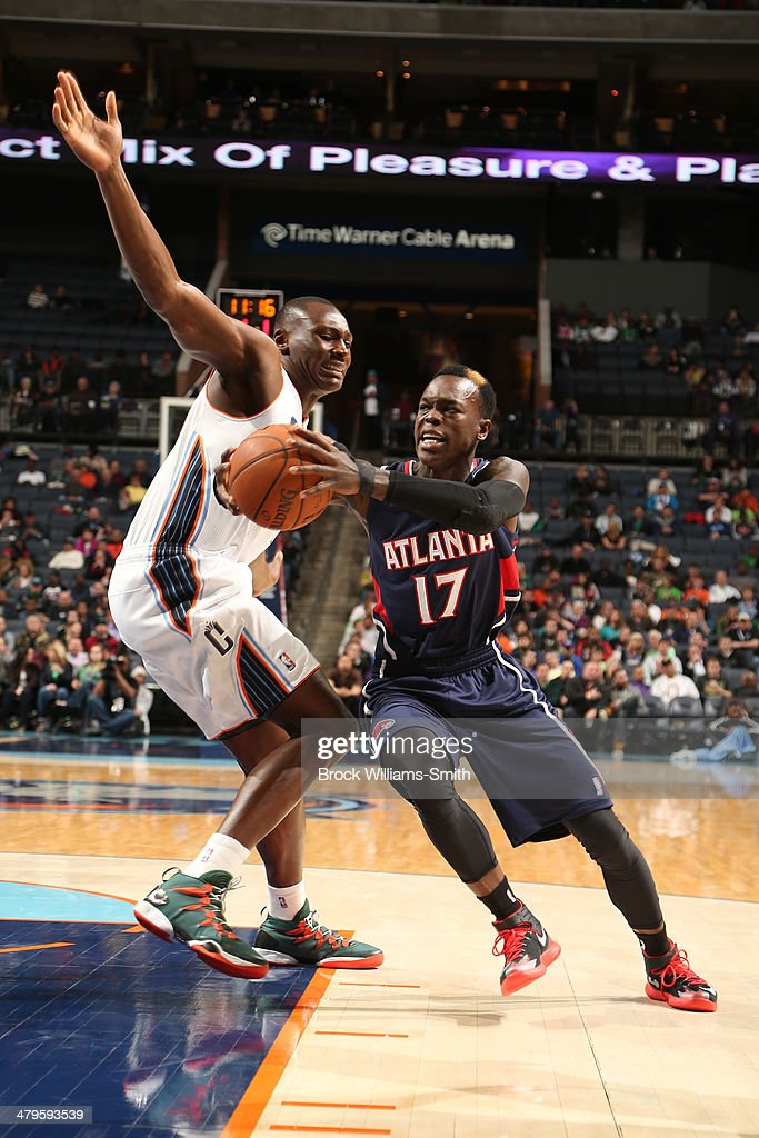 Dennis Schroder #17 of the Atlanta Hawks drives to the basket during the game against the Charlotte Bobcats at the Time Warner Cable Arena on March 17, 2014 in Charlotte, North Carolina.