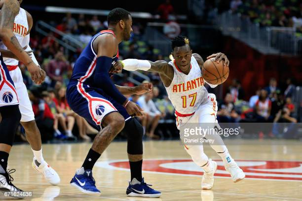 Dennis Schroder of the Atlanta Hawks drives to the basket past John Wall of the Washington Wizards during the first quarter in Game Three of the...