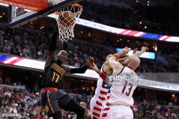 Dennis Schroder of the Atlanta Hawks dunks the ball in front of Marcin Gortat of the Washington Wizards in the second half in Game Two of the Eastern...