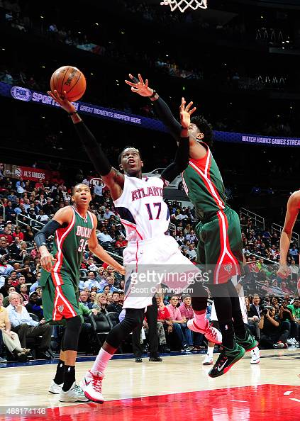 Dennis Schroder of the Atlanta Hawks goes for the layup against the Milwaukee Bucks during the game on March 30 2015 at Philips Arena in Atlanta...