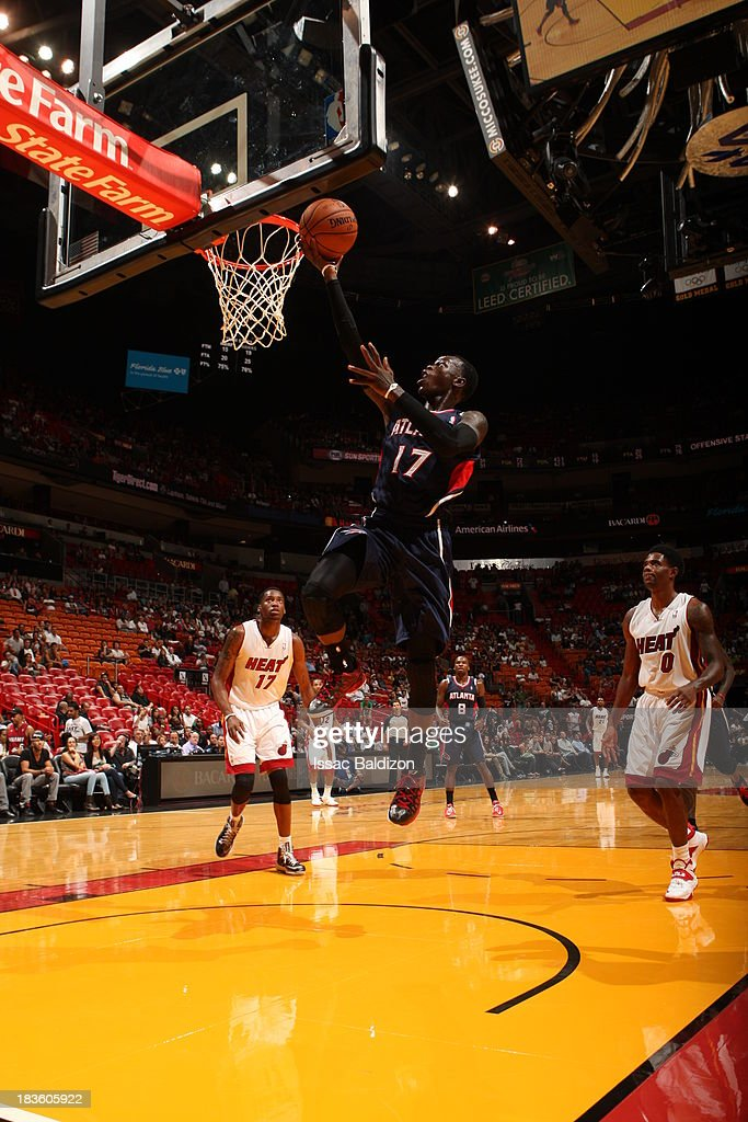Dennis Schroder #17 of the Atlanta Hawks goes up for the dunk against the Miami Heat during a game on October 7, 2013 at American Airlines Arena in Miami, Florida.