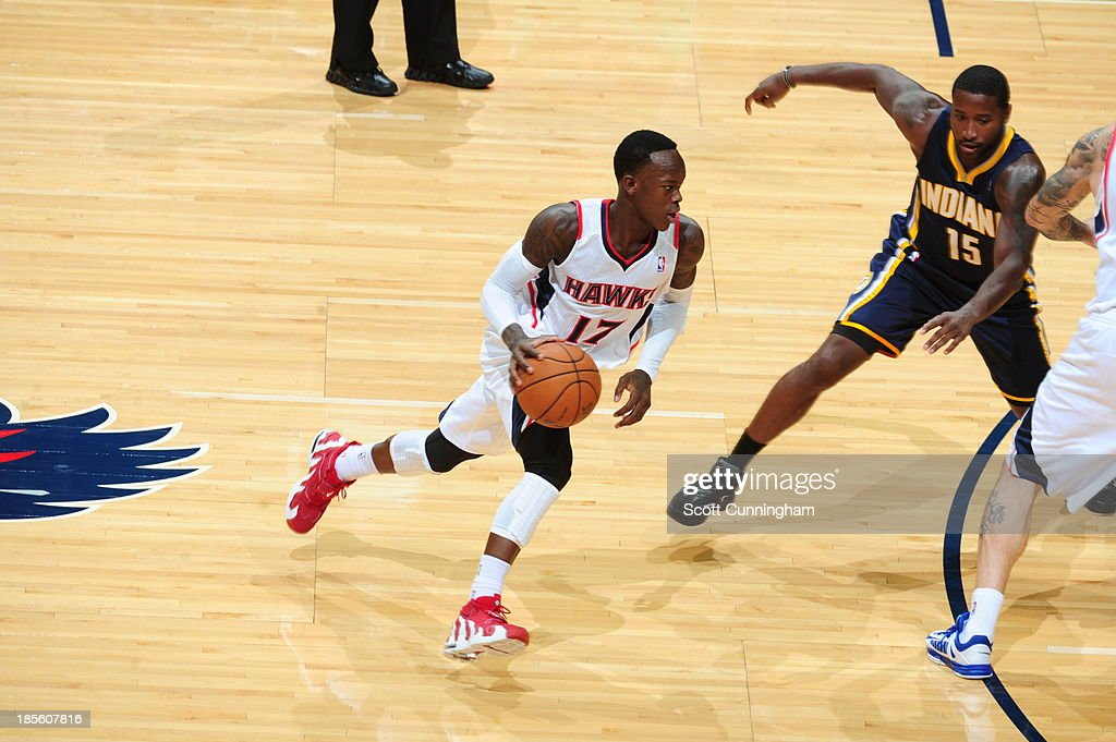 Dennis Schroder #17 of the Atlanta Hawks handles the ball against <a gi-track='captionPersonalityLinkClicked' href=/galleries/search?phrase=Donald+Sloan&family=editorial&specificpeople=4185817 ng-click='$event.stopPropagation()'>Donald Sloan</a> #15 of the Indiana Pacers on October 22, 2013 at Philips Arena in Atlanta, Georgia.