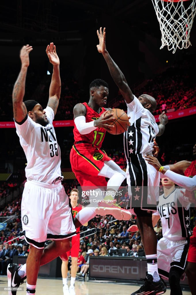 Dennis Schroder #17 of the Atlanta Hawks handles the ball against the Brooklyn Nets on March 26, 2017 at Philips Arena in Atlanta, Georgia.