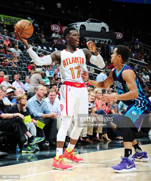 Dennis Schroder of the Atlanta Hawks handles the ball against the Charlotte Hornets during the game on April 11 2017 at Philips Arena in Atlanta...