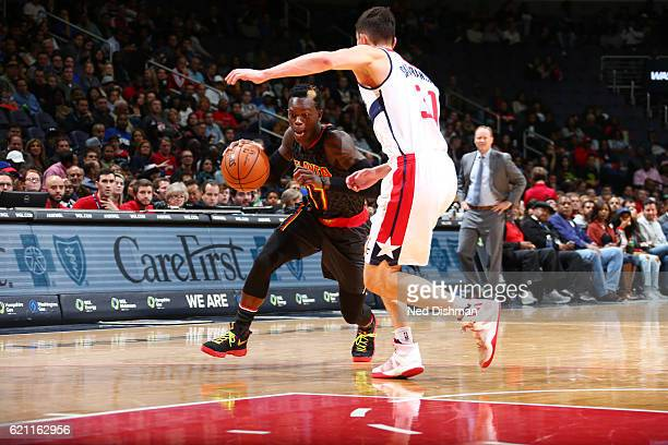 Dennis Schroder of the Atlanta Hawks handles the ball against Tomas Satoransky of the Washington Wizards during a game on November 4 2016 at the...