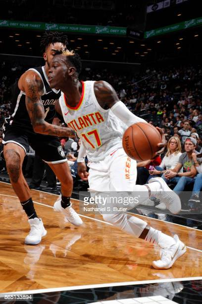 Dennis Schroder of the Atlanta Hawks handles the ball during the game against the Brooklyn Nets on October 22 2017 at Barclays Center in Brooklyn New...