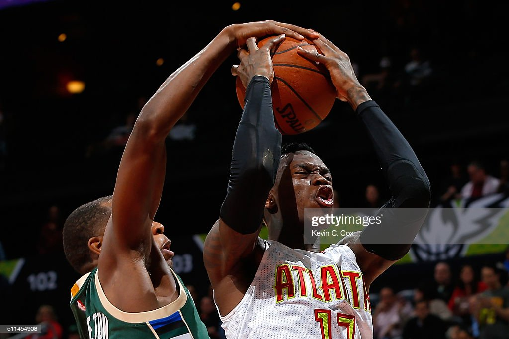 Dennis Schroder #17 of the Atlanta Hawks has his shot blocked by Khris Middleton #22 of the Milwaukee Bucks in the second overtime of their 117-109 loss at Philips Arena on February 20, 2016 in Atlanta, Georgia. NOTE TO USER User expressly acknowledges and agrees that, by downloading and or using this photograph, user is consenting to the terms and conditions of the Getty Images License Agreement.