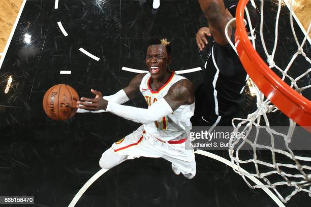 Dennis Schroder of the Atlanta Hawks photos the ball during the game against the Brooklyn Nets on October 22 2017 at Barclays Center in Brooklyn New...